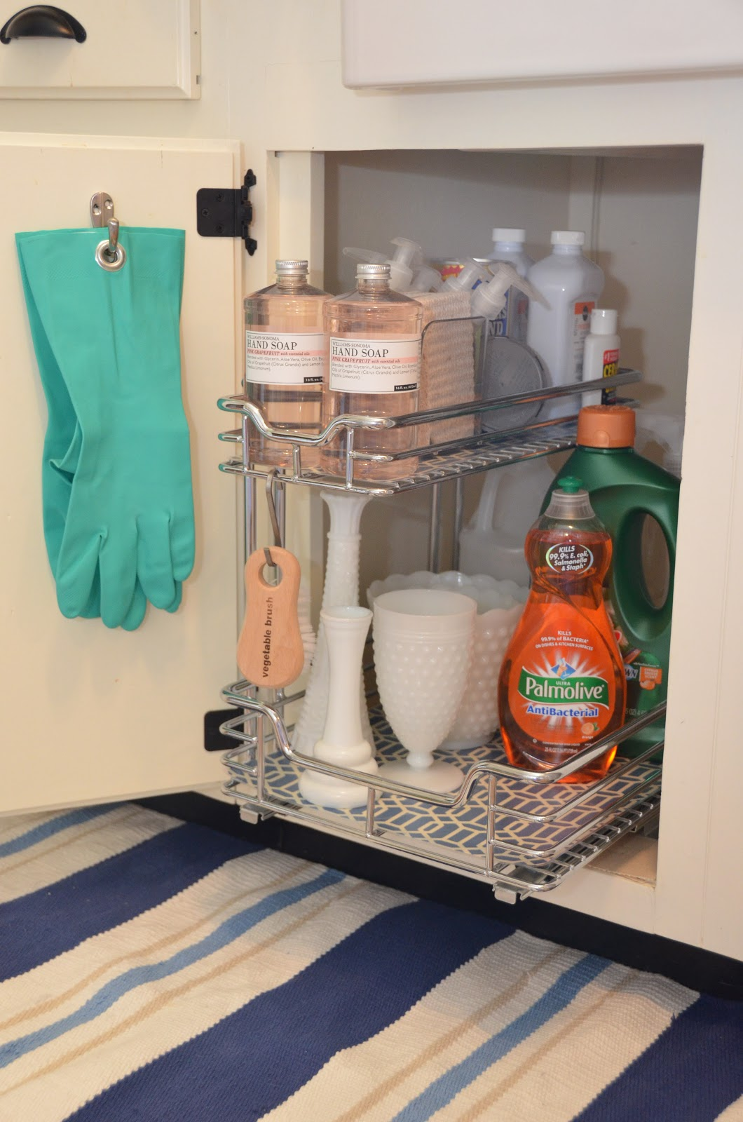 16 renovations under your sink that will wow for Bathroom under sink organizer