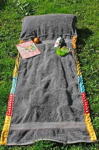 beach towel and pillow combo lying on grass