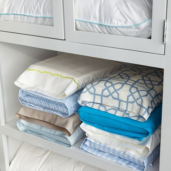 linen placed in pillow cases for closet organization