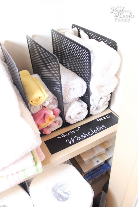 linen small closet organization - wash cloths stacked in neat rows
