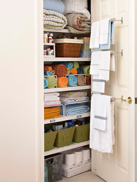 towel rod organization within linen closet - great for small closets