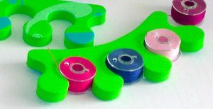 sewing tips - store bobbins in a foam toe separator
