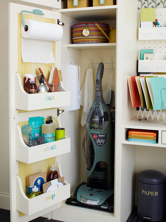 cleaning supplies stored in shelving inside cabinet