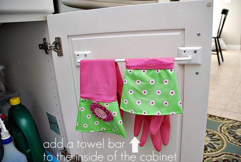 how to store cleaning supplies-install a towel bar on the inside of cabinet door