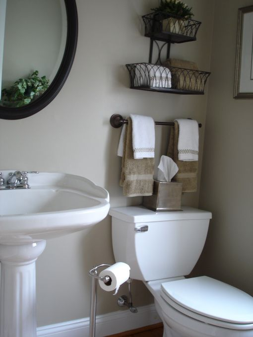 17 brilliant over the toilet storage ideas for Small washroom design ideas
