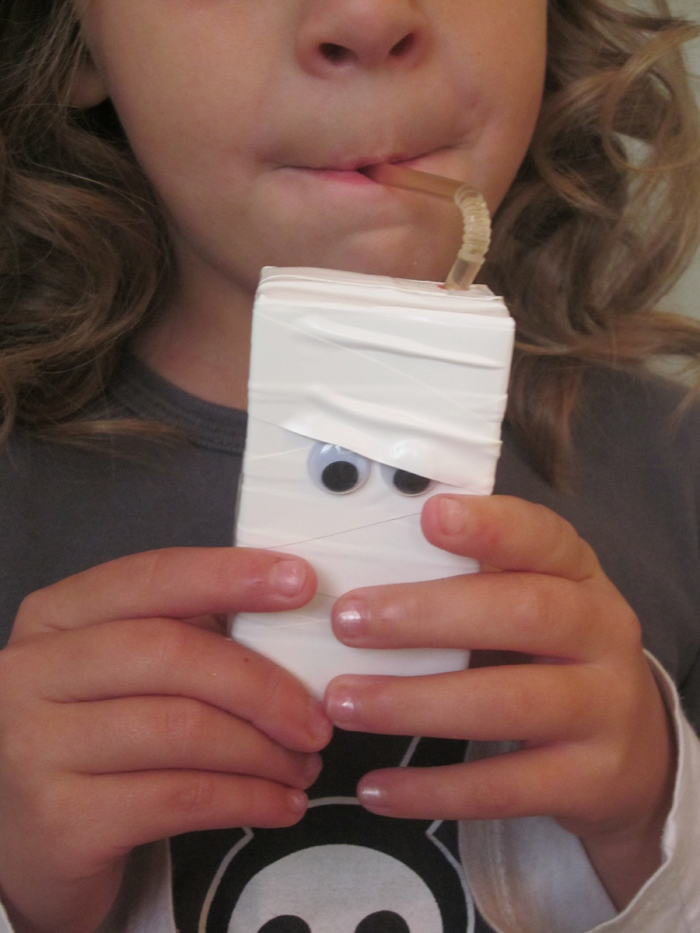 white juice boxes with eyes