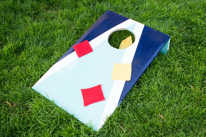 DIY cornhole board on the grass with bean bags