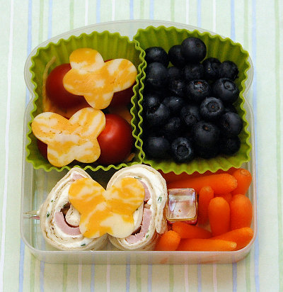 cream cheese and ham pinwheels with fruit and carrots