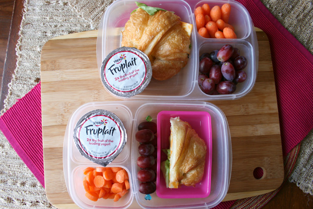 croissant sandwich with yogurt, carrots and grapes