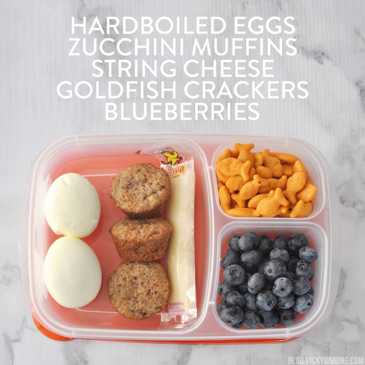 bento lunch idea with hardboiled eggs, muffins, crackers, fruit and cheese