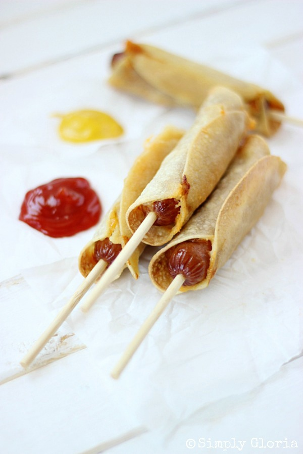 baked corn tortilla cheese dogs on a counter