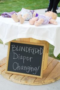 Outdoor blind diaper changing game