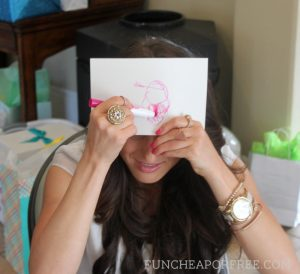 woman drawing a baby on an index card