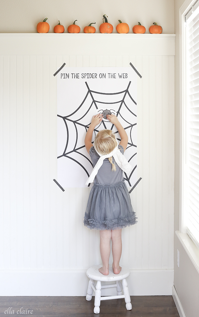 girl playing pin the spider on the web