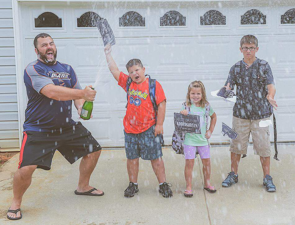 Dad pops the bubbly while kids look upset about going back to school