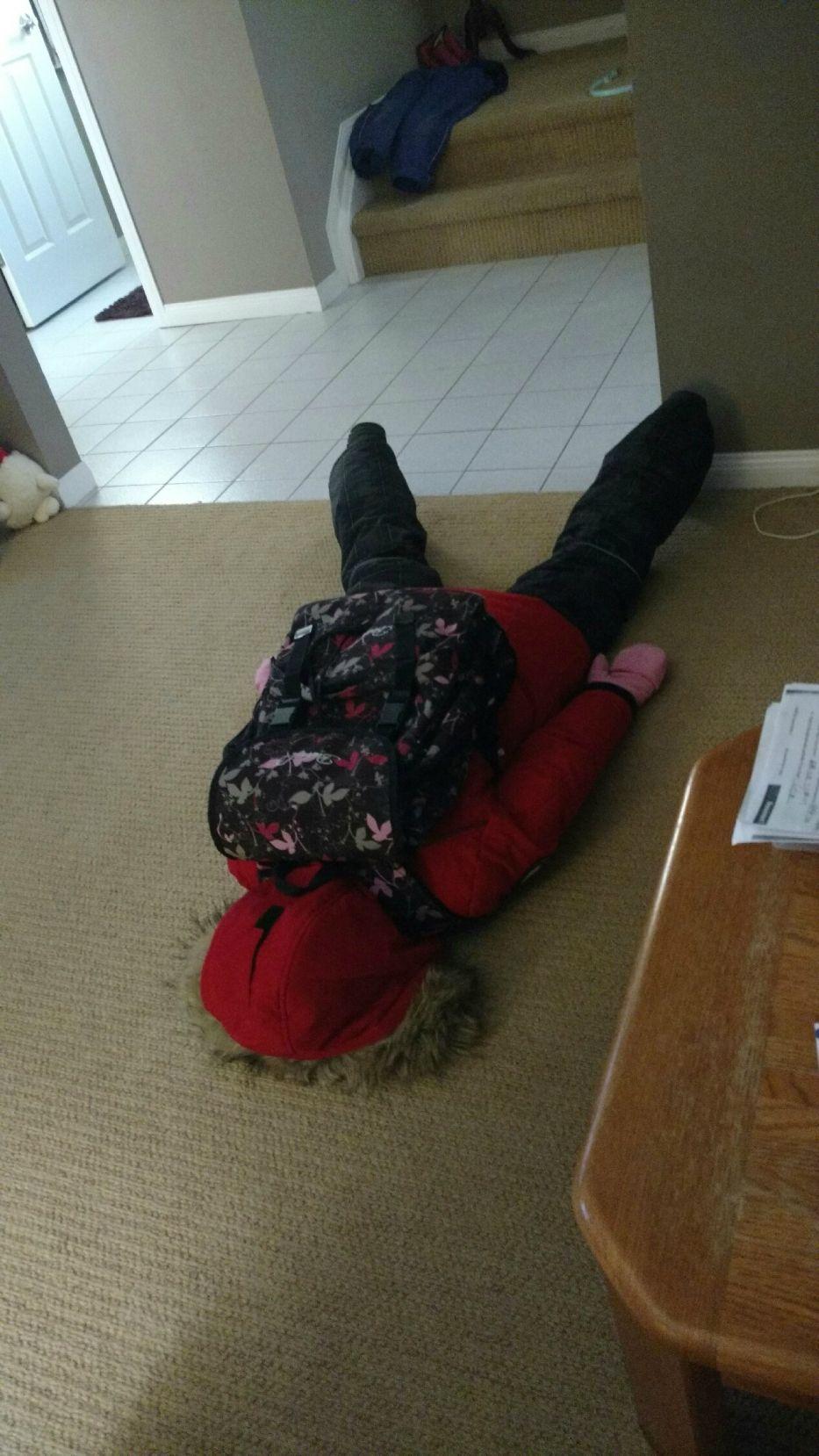little girl face down on the floor in despair
