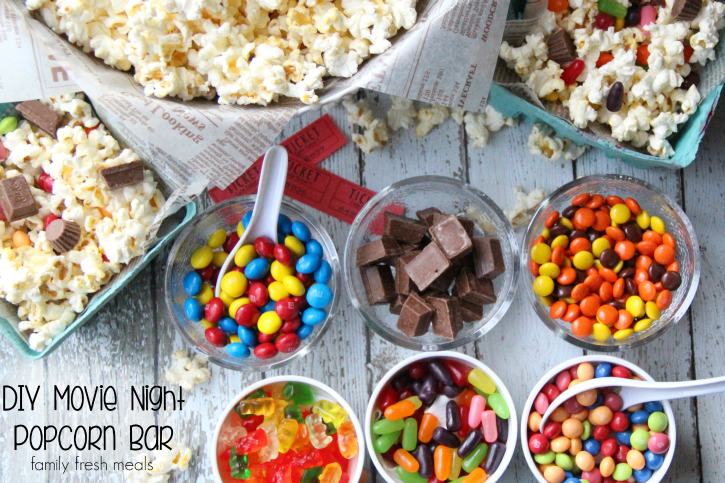 DIY popcorn bar for slumber parties and movie nights - some ingredient ideas for a sleepover party popcorn bar include m and ms, chocolate bars, reeses pieces, gummy bears, and mike n ikes
