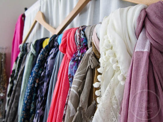 scarves-knotted-over-clothes-hangers