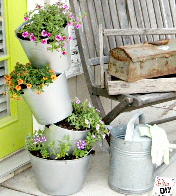 16 diy flower pots to get you giddy about gardening for Plastic fish bowls dollar tree