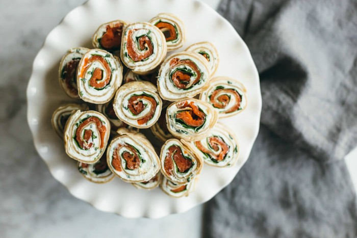 spinach and smoked salmon pinwheels on a plate