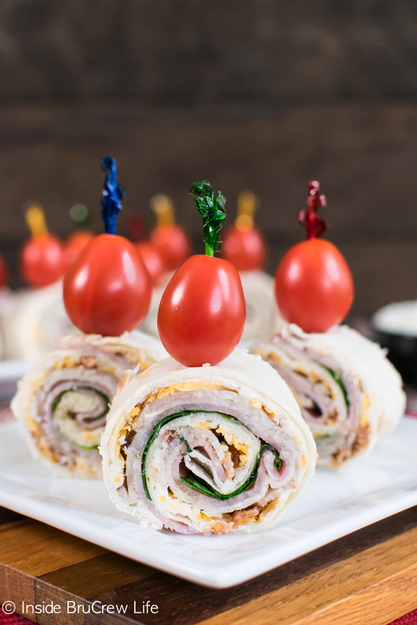 turkey club pinwheels with cherry tomatoes on top