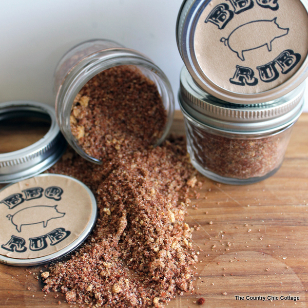 2 mini mason jars: one filled with BBQ rub and one jar on its side with rub spilling out