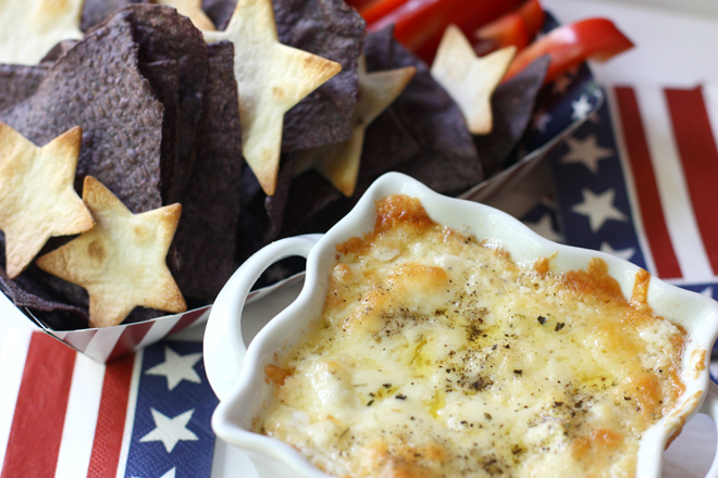 cheese and onion dip served with blue and white corn chips for 4th of july party