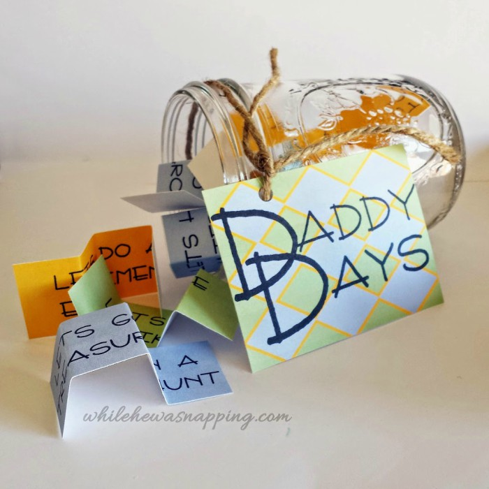 """Mason jar lying sideways with a label that says """"Daddy Days"""" and folded cards with adventure ideas written on them"""