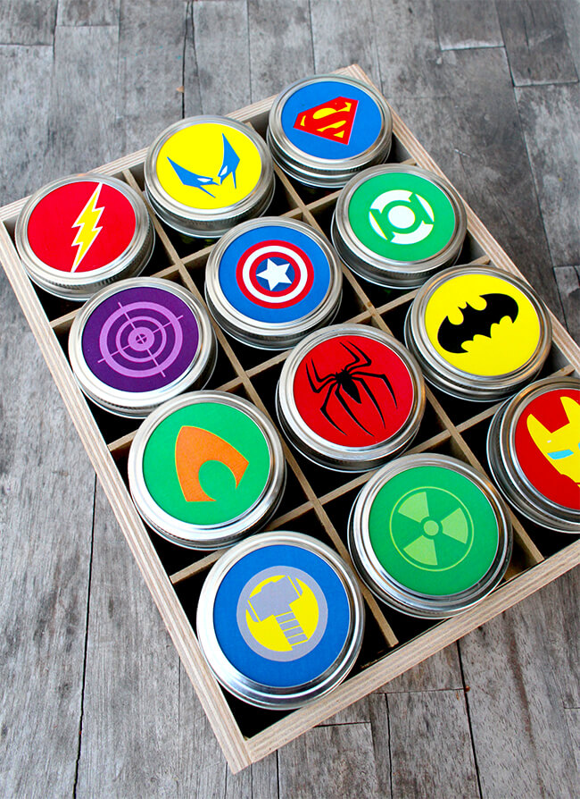crate of 12 mason jars with super hero labels on each lid
