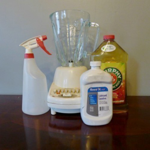 A bottle of Murphy's Oils Soap with a blender, spray bottle and mineral oil