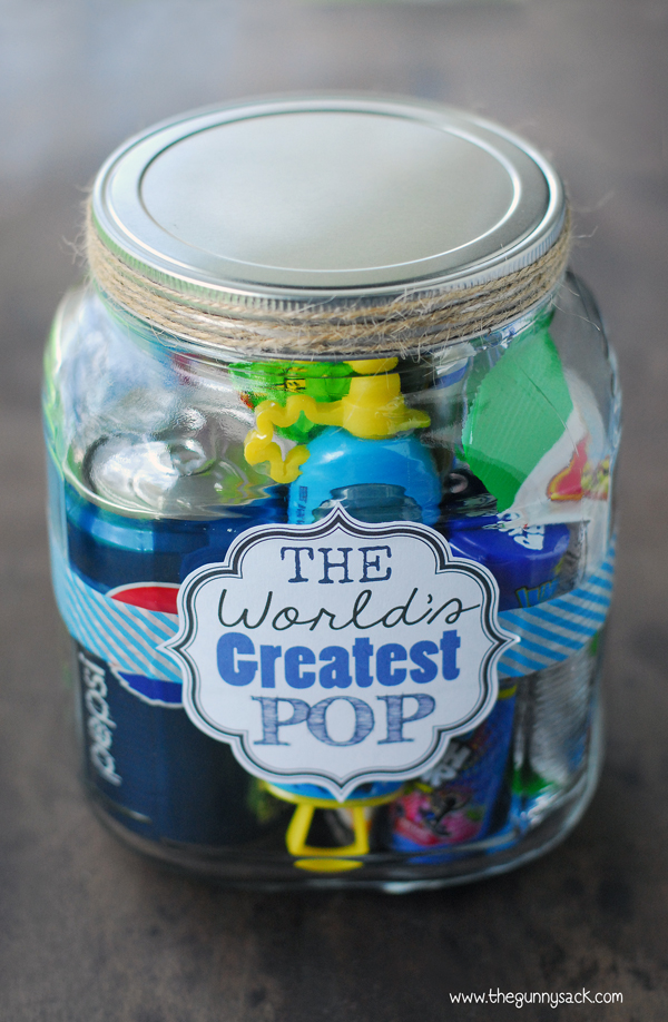 """mason jar filled with """"pop"""" themed items and a label that says """"The World's Greatest Pop"""""""