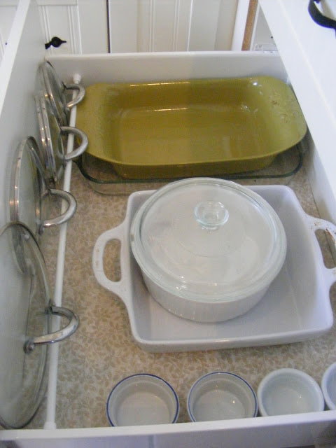Tension rod hack for pot lids by The Complete Guide to Imperfect Homemaking