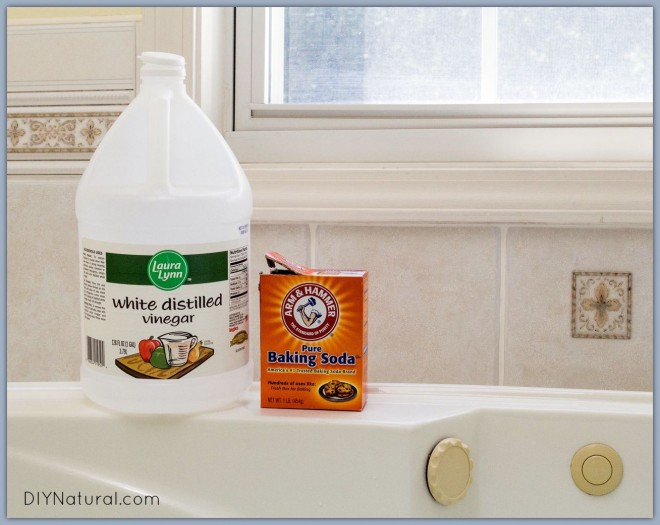 vinegar and baking soda on edge of a tub