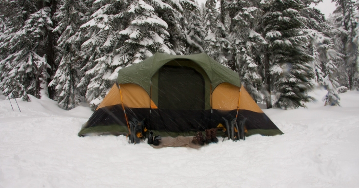 tent set up for winter camping on the snowy ground