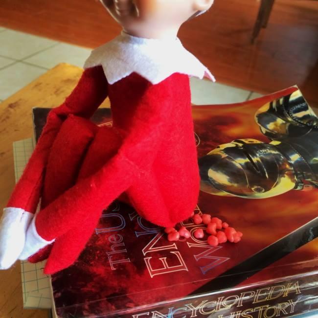 Elf sitting on book