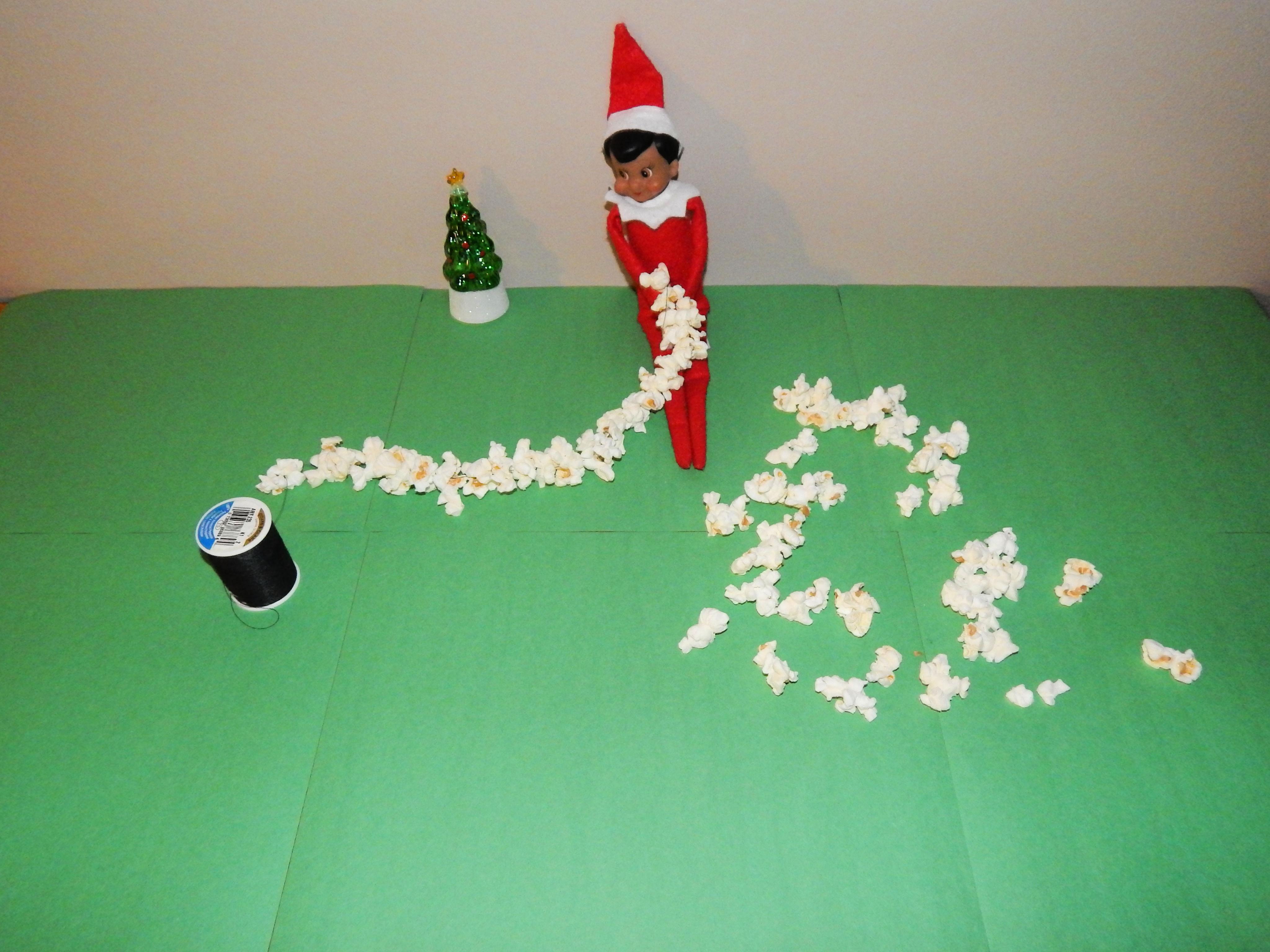 Elf On The Shelf Stringing Popcorn