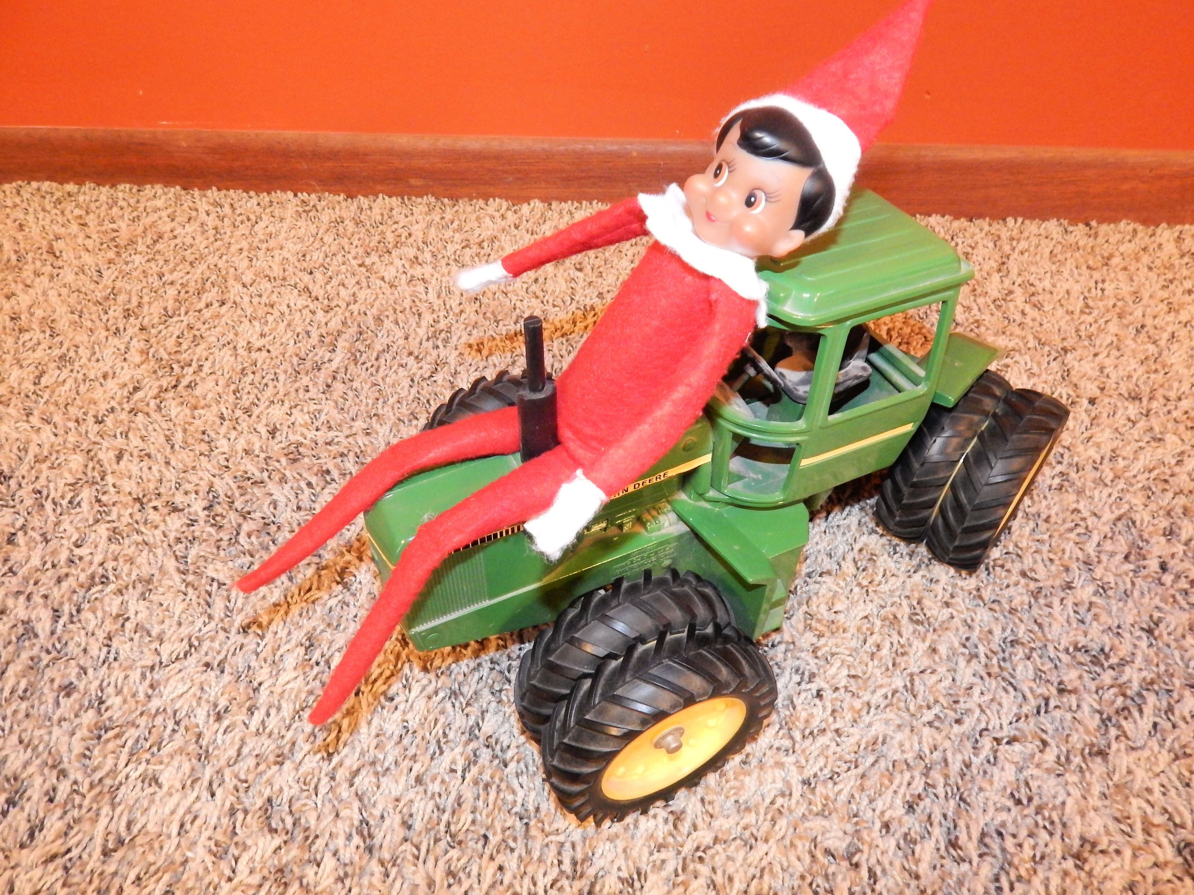 green tractor on carpet