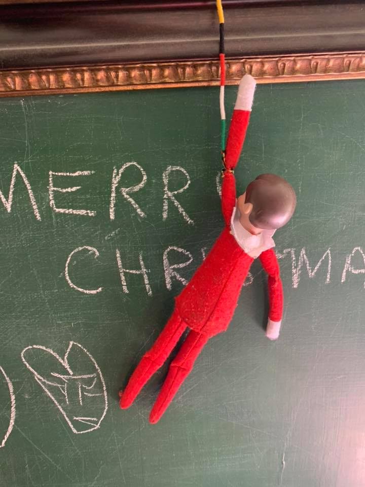 Elf on the Shelf Hanging From Chalkboard