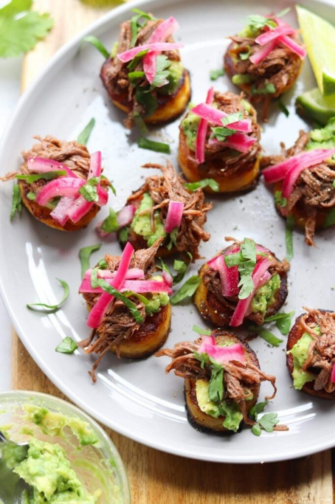 Enjoy Mexican appetizers like these Barbacoa beef and plaintain sliders