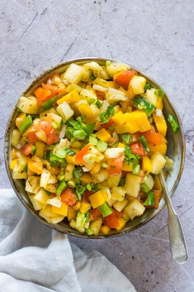 Enjoy Mexican appetizers like this easy mango pineapple salsa