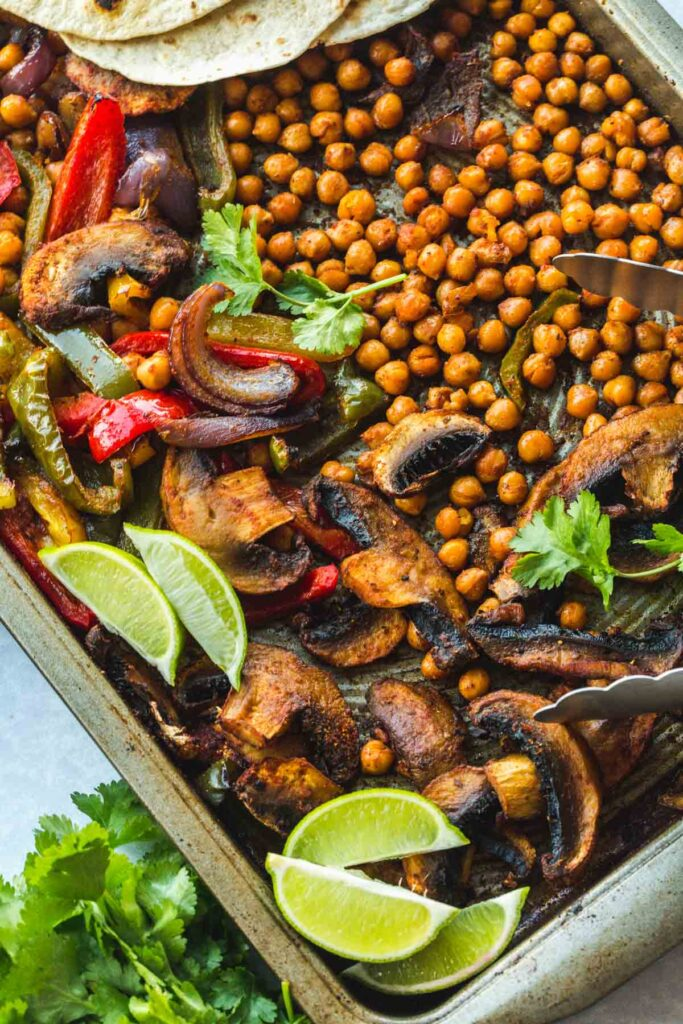 Chickpea fajitas with a lemon dressing cooked on a sheet pan.