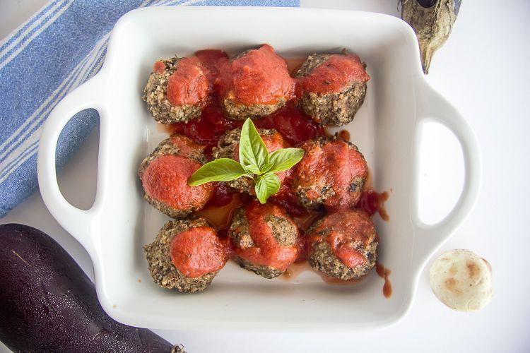 Keto eggplant meatballs in a white baking dish.