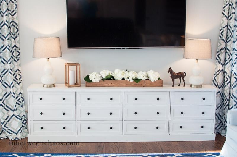 long white media console with black knobs