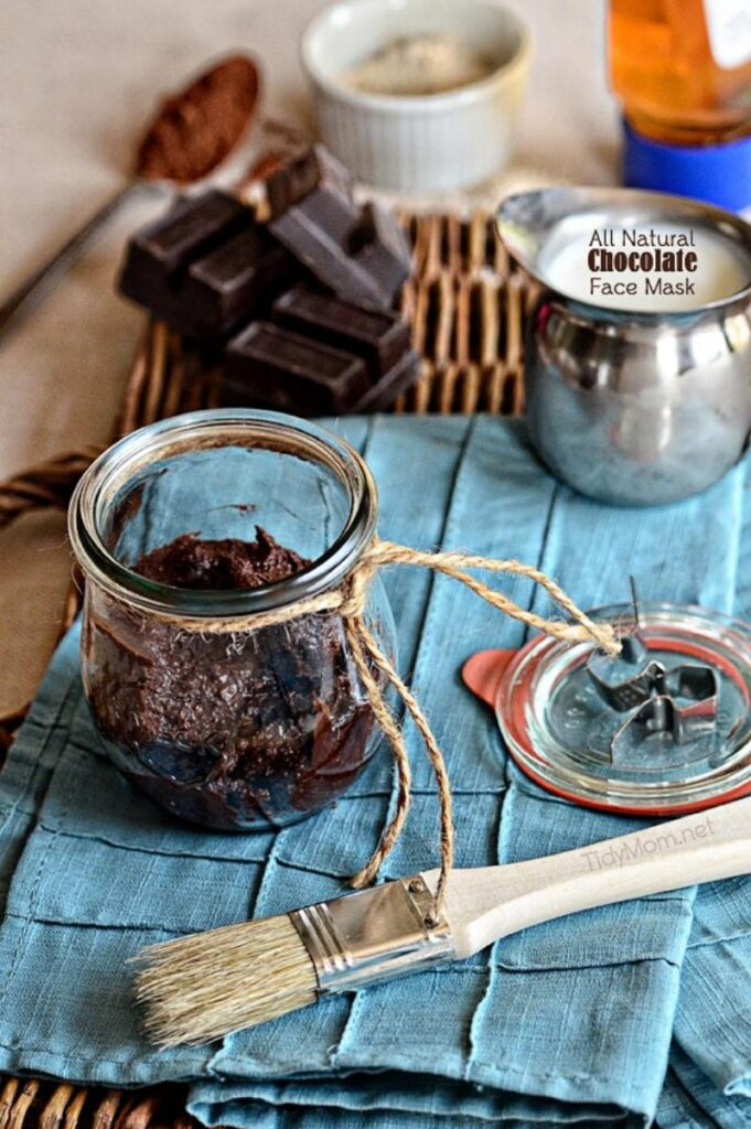 chocolate face mask in a jar on a table