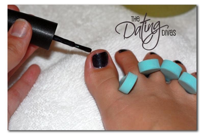 pedicure with black painted toenails