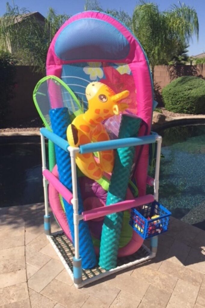 DIY PVC pool toy storage crate full of pull toys