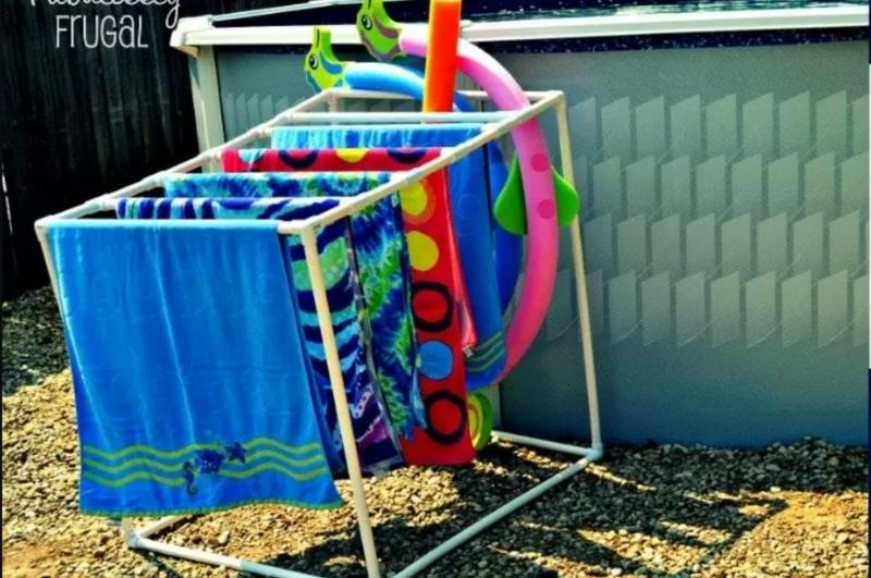 DIY pool towel storage and drying rack from PVC pipes with towels on it