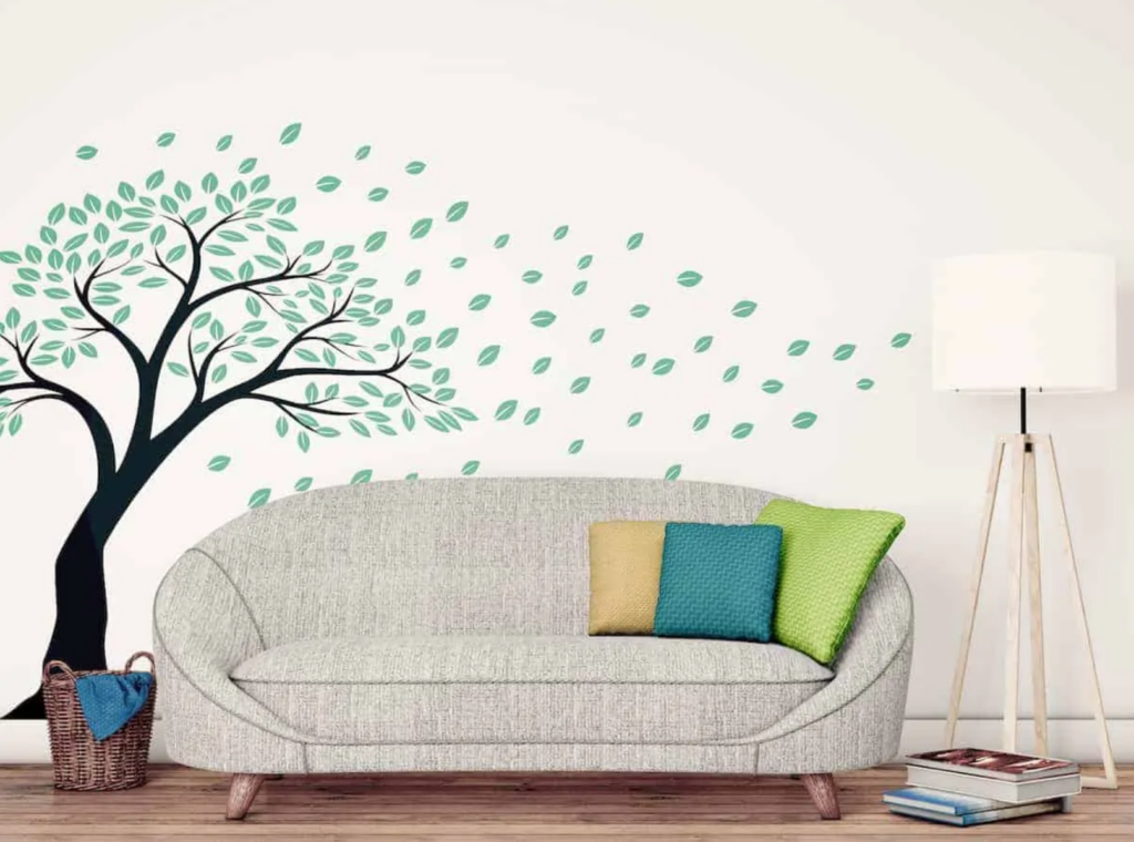 apartment decorating ideas: room with a couch and a tree wall decal