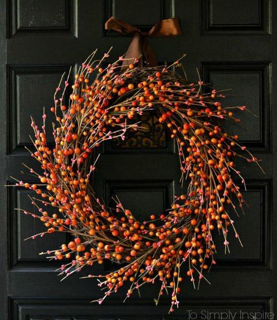 DIY rustic fall wreath hanging on a door