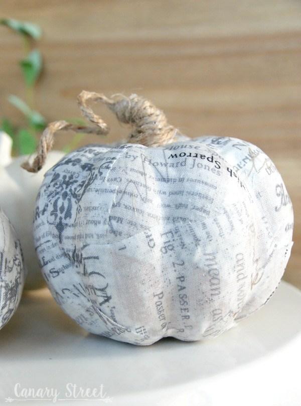 decoupaged faux pumpkin with twine stem